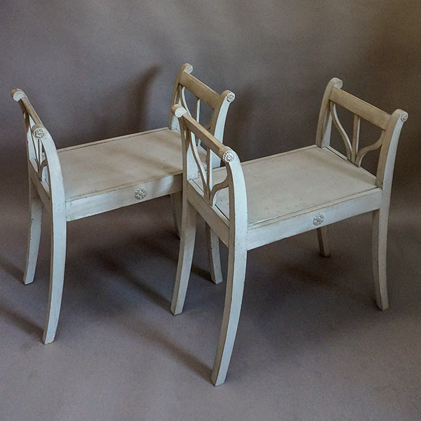 Pair of stools with curved arms and saber legs, Sweden circa 1860.