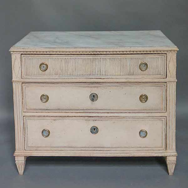 Swedish empire chest of drawers with marbled top.