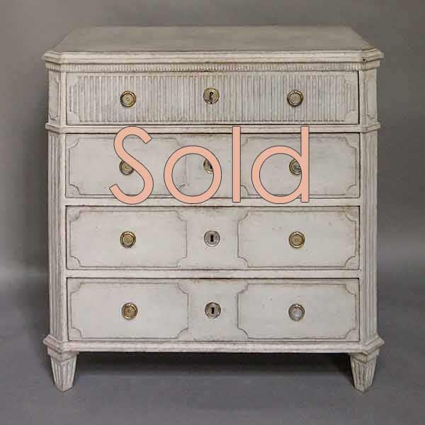 Swedish empire four-drawer chest