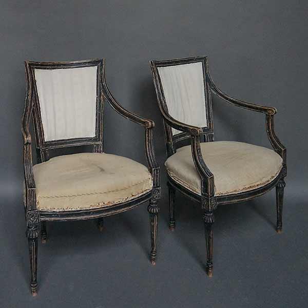 Pair of Swedish ebonized armchairs.