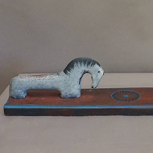 Danish mangle board with white horse.