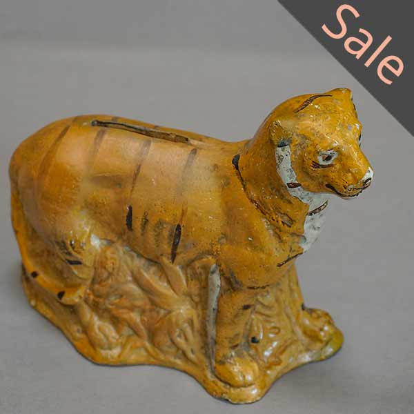 Chalkware bank in the shape of a tiger