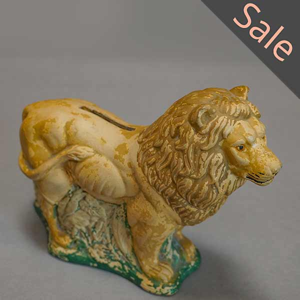 Ceramic bank in the form of a lion with a painted green base, Denmark
