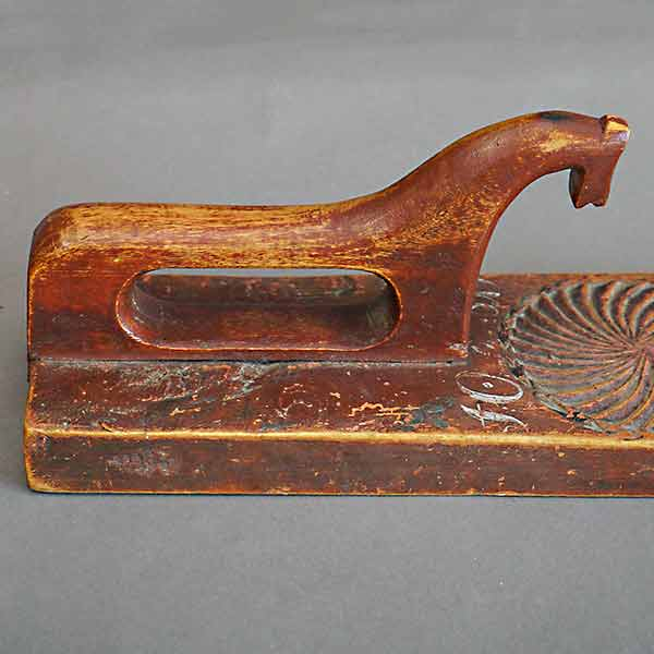 Beautiful Swedish mangle board dated 1819 with simple horse handle and chip carved in geometric designs.