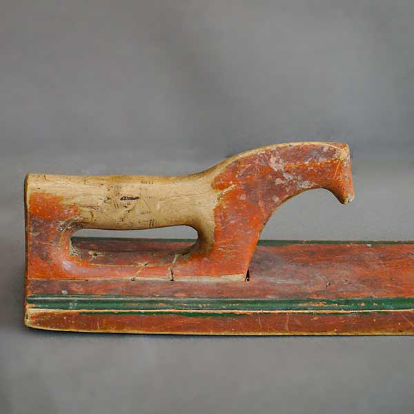 Swedish mangle board with horse handle and red paint.