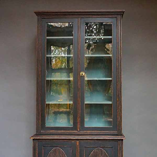 Gustavian style antique library with glass doors.