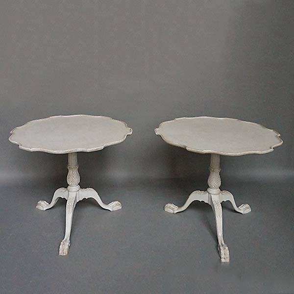 Pair of antique pie crust tables with claw and ball feet